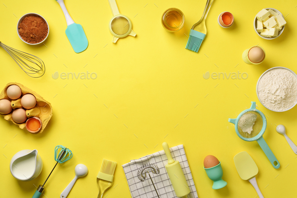 Time to bake. Baking ingredients - butter, sugar, flour, eggs, oil, spoon, rolling pin, brush, whisk - Stock Photo - Images