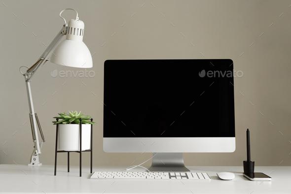 Designer workspace. Minimalistic home office. Blank screen desktop computer, Mockup desktop computer - Stock Photo - Images