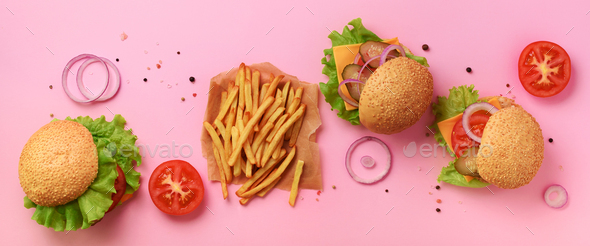 Fast food banner. Juicy meat burgers with beef, tomato, cheese, onion, cucumber and lettuce on pink - Stock Photo - Images