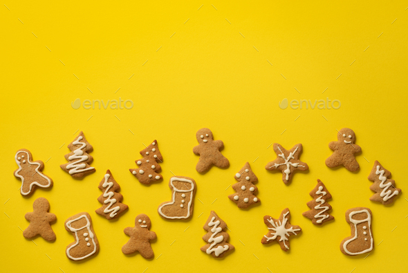 Christmas handmade cookies on yellow background with copy space. Pattern of gingerbread men - Stock Photo - Images