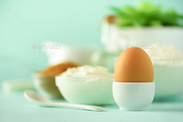 White cooking utensils on blue background. Food ingredients. Macro of egg. Cooking cakes and baking - Stock Photo - Images