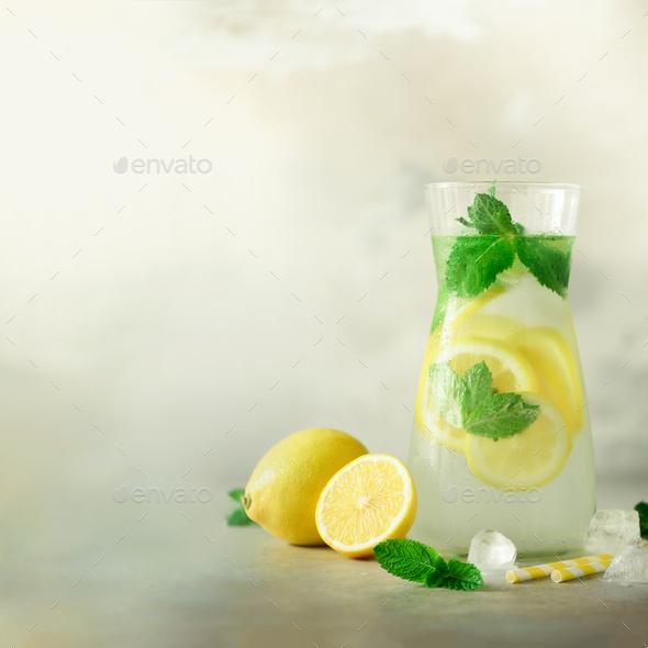 Citrus lemonade - mint, lemon and tropical monstera leaves on grey background. Square crop. Detox - Stock Photo - Images