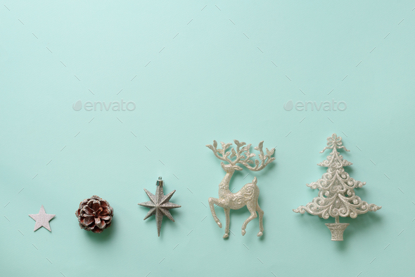 Festive silver dear, stars, fir-tree, cone on blue background with copy space. Christmas and new - Stock Photo - Images