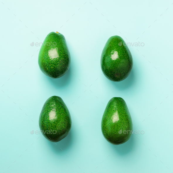 Green avocado pattern on blue background. Top view. Pop art design, creative summer food concept - Stock Photo - Images
