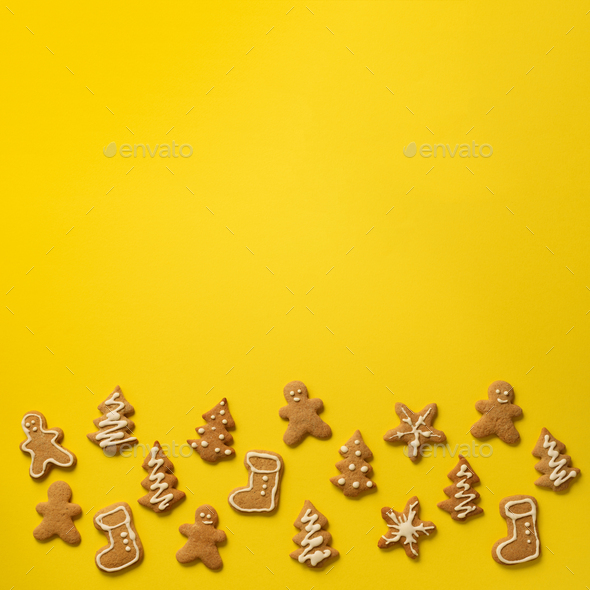 Homemade christmas cookies on yellow background with copy space. Square crop. Pattern of gingerbread - Stock Photo - Images