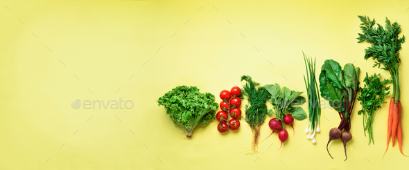 Organic vegetables on yellow background with copy space. Banner. Top view of carrot, beet, pepper - Stock Photo - Images
