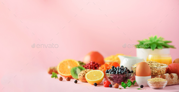 Healthy breakfast ingredients, food frame. Oat and corn flakes, eggs, nuts, fruits, berries, toast - Stock Photo - Images