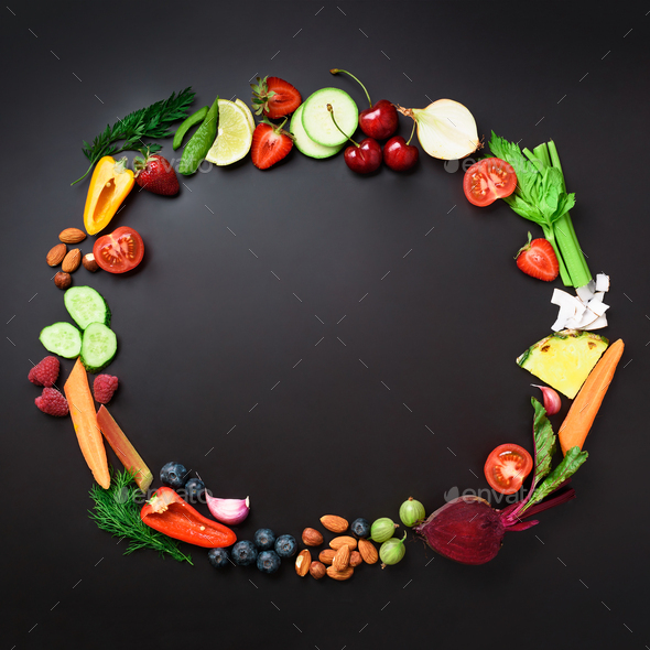 Healthy food background. Circle of organic vegetables, fruits, nuts, berries with copy space on - Stock Photo - Images