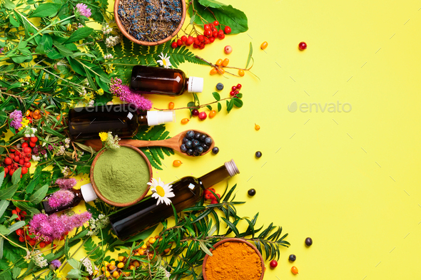 Natural herbal ingredients for alternative medicine on yellow background. Natural skin care beauty - Stock Photo - Images