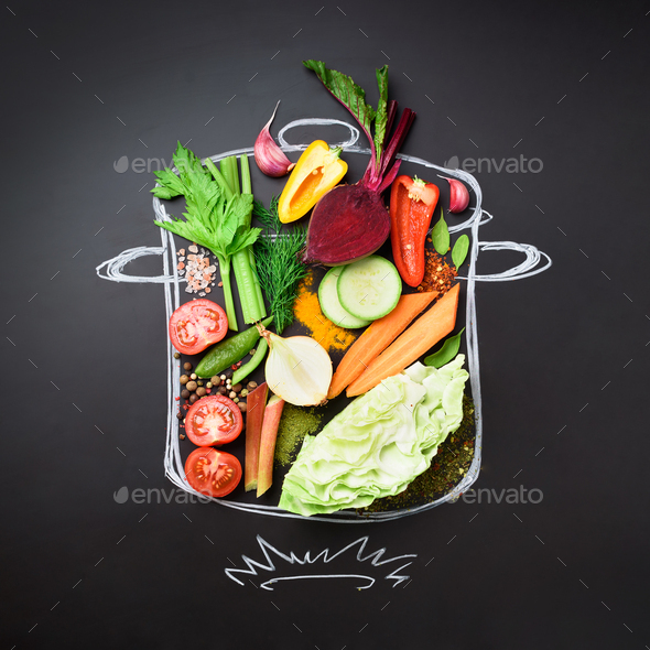 Food ingredients for blending creamy soup on painted stewpan over chalkboard. Top view with copy - Stock Photo - Images