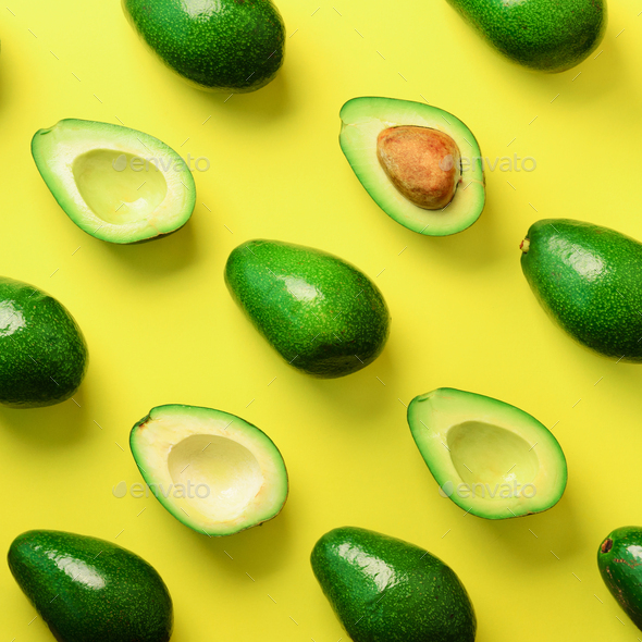 Avocado pattern on yellow background. Top view. Banner. Pop art design, creative summer food concept - Stock Photo - Images