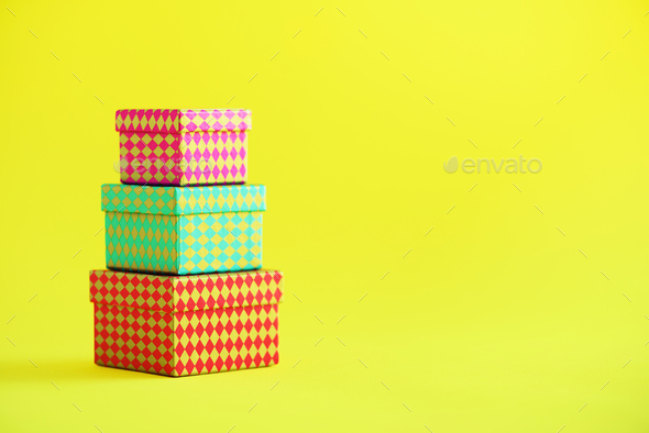Collection of colorful gift boxes on yellow background. Presents for birthday party. Christmas and - Stock Photo - Images