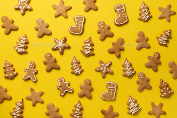 Christmas handmade cookies on pink background. Pattern of gingerbread men, snowflake, star, fir-tree - Stock Photo - Images