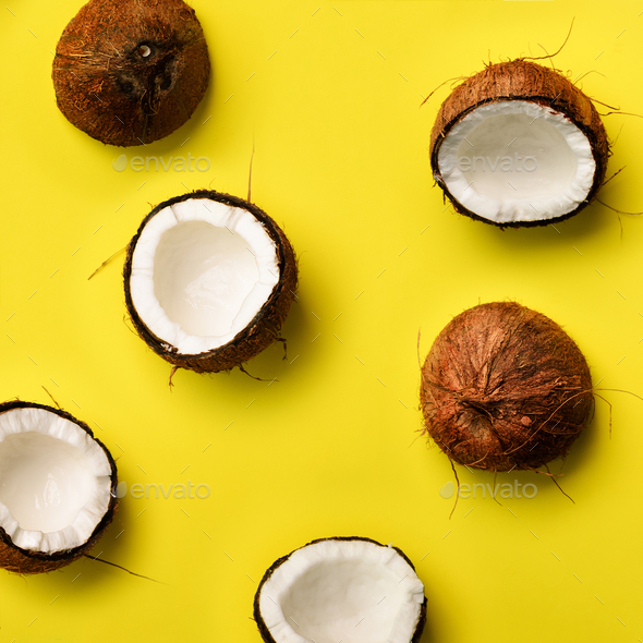 Pattern with ripe coconuts on yellow background. Top View. Copy Space. Square crop. Pop art design - Stock Photo - Images