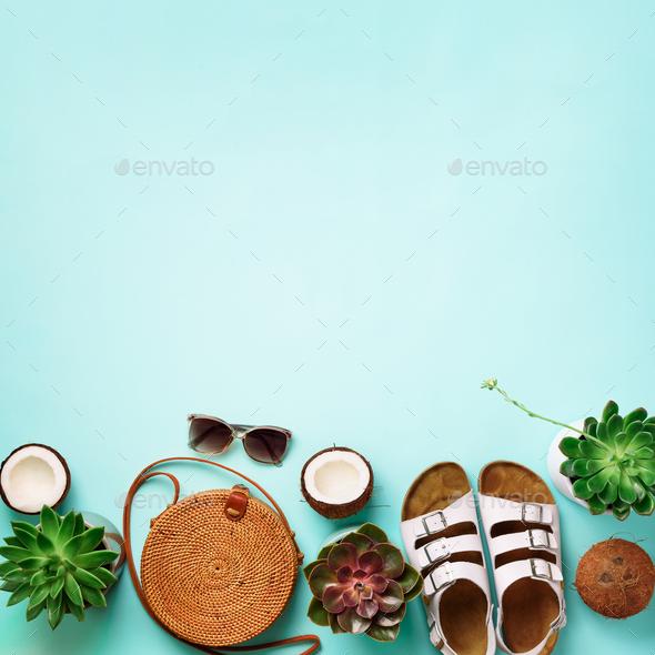 Stylish rattan bag, coconut, birkenstocks, succulent, sunglasses on blue background. Banner. Top - Stock Photo - Images