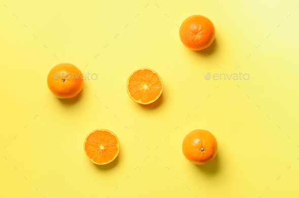 Fruit pattern of fresh orange slices on yellow background. Top view. Copy Space. Pop art design - Stock Photo - Images