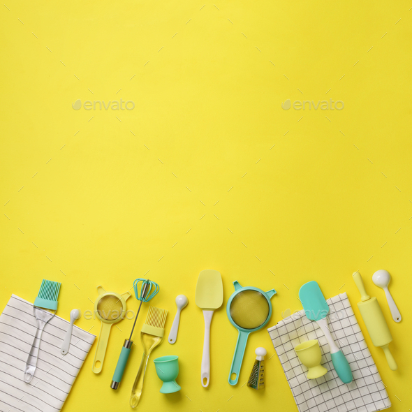 Turquoise cooking utensils on yellow background. Food ingredients. Cooking cakes and baking bread - Stock Photo - Images