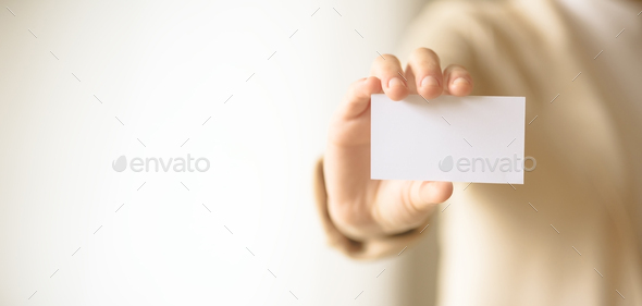 Businessman holding empty business card with copy space. Mock up. Business, study, network concept - Stock Photo - Images