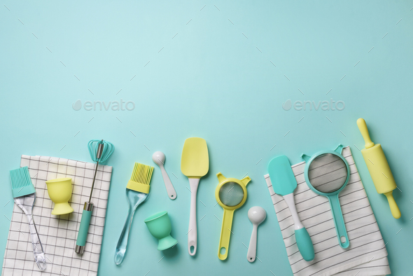 Time to cook. Pastel yellow, blue cooking utensils on turquoise background. Food ingredients - Stock Photo - Images