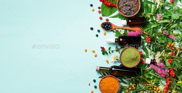 Healthy super food, berries, turmeric, spirulina, omega acid capsules, vitamin c supplement - Stock Photo - Images