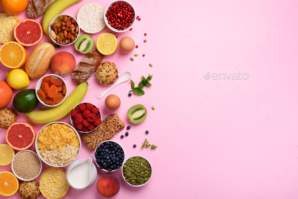 Organic food frame. Healthy breakfast ingredients. Oat and corn flakes, eggs, nuts, fruits, berries - Stock Photo - Images