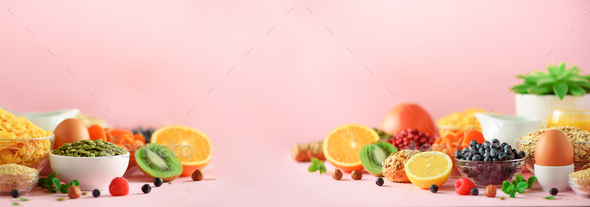 Organic food frame. Banner. Healthy breakfast ingredients. Oat and corn flakes, eggs, nuts, fruits - Stock Photo - Images