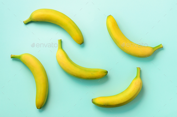 Colorful fruit pattern. Bananas over blue background. Top view. Pop art design, creative summer - Stock Photo - Images