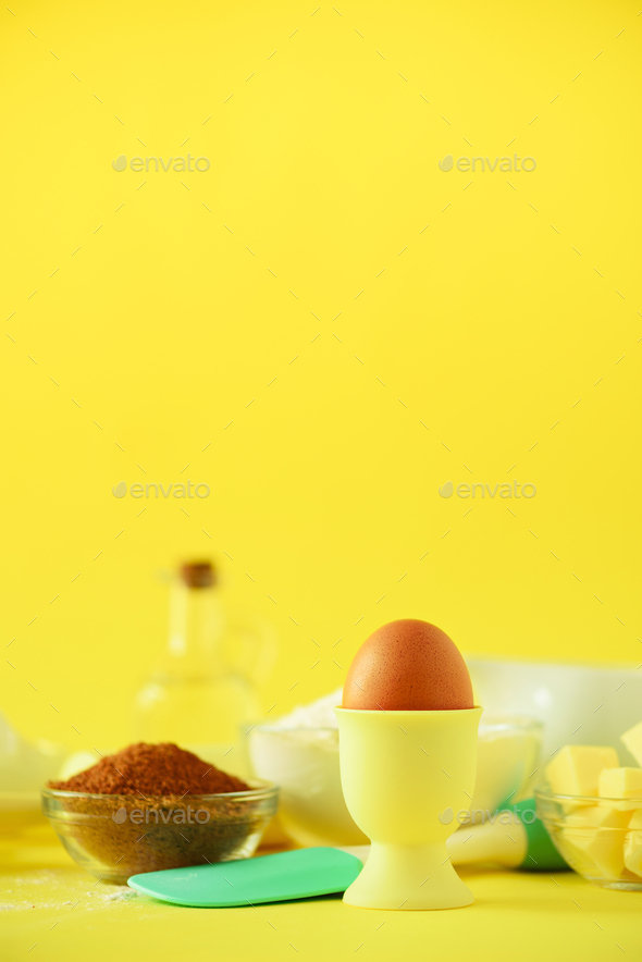 Healthy baking ingredients - butter, sugar, flour, eggs, oil, spoon, rolling pin, brush, whisk, milk - Stock Photo - Images