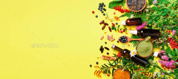 Holistic medicine approach. Healthy food eating, dietary supplements, healing herbs and flowers - Stock Photo - Images