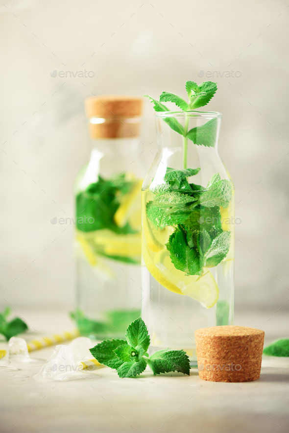 Citrus lemonade - mint, lemon and tropical monstera leaves on grey background. Detox drink. Summer - Stock Photo - Images
