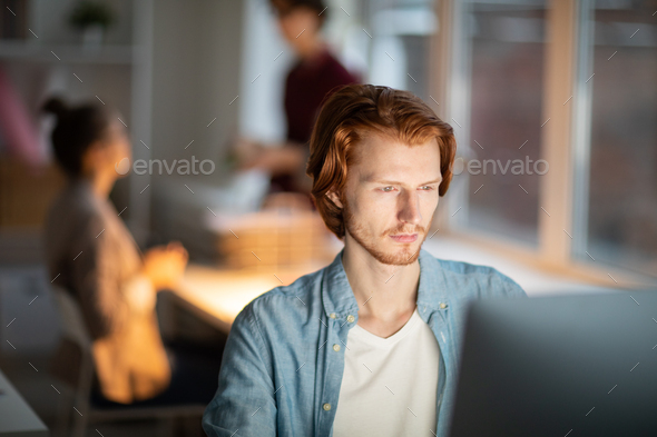 Man in front of computer - Stock Photo - Images