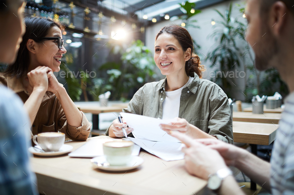 Cheerful startuppers working on new project - Stock Photo - Images