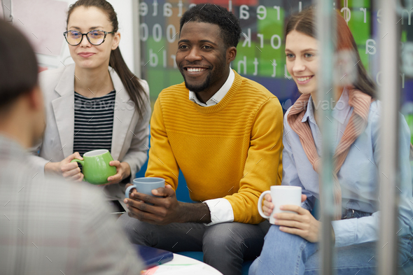 Young People Chatting on Break - Stock Photo - Images