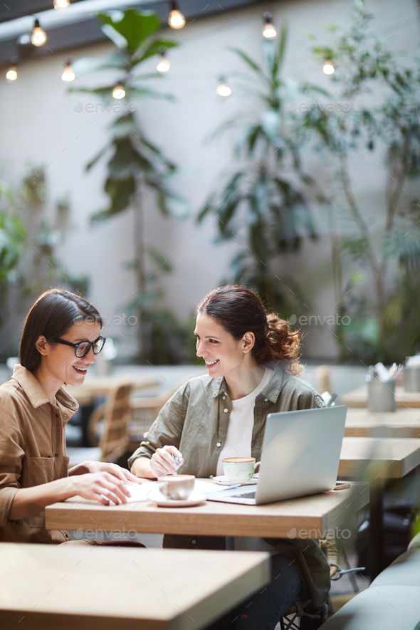 Female entrepreneurs elaborating strategy - Stock Photo - Images