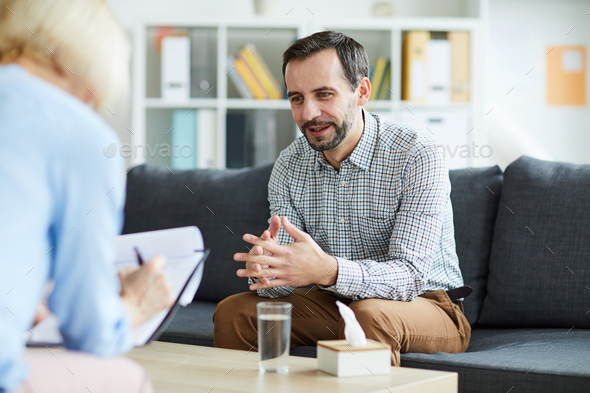 Man visiting counselor - Stock Photo - Images