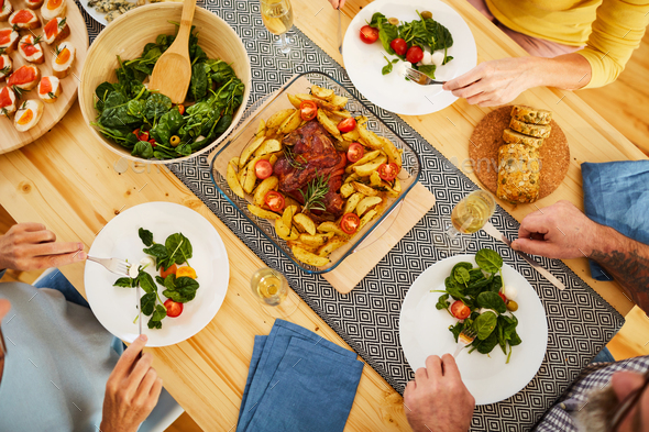 Roasted pork with potatoes on dining table - Stock Photo - Images