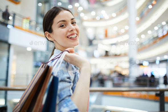 Portrait of lady in shopping mall - Stock Photo - Images