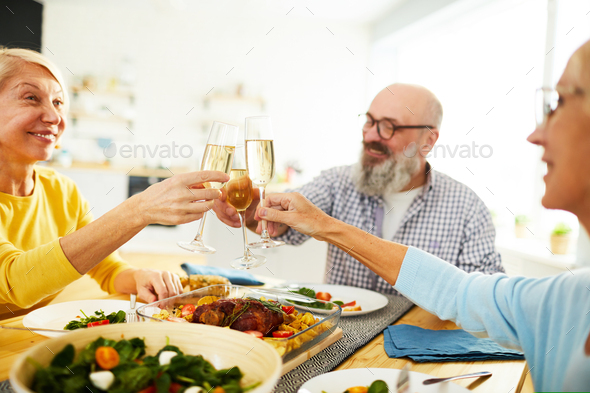 Drinking toast at dinner party - Stock Photo - Images
