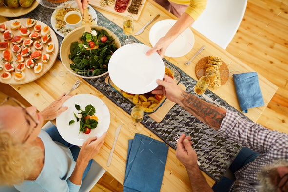Giving plate to put salad - Stock Photo - Images