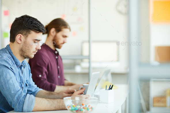 Young employee at work - Stock Photo - Images