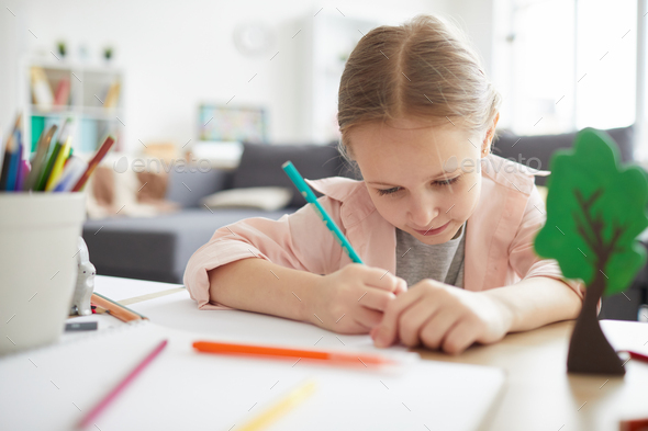 Cute little Girl Studying - Stock Photo - Images