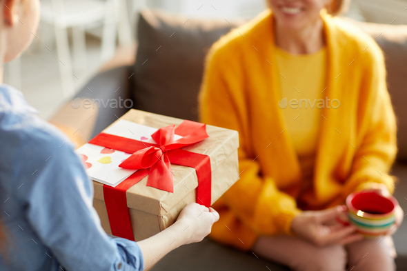 Children Presenting Gift for Mom - Stock Photo - Images