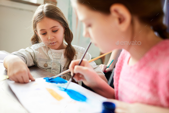 Two Sisters Painting Together - Stock Photo - Images