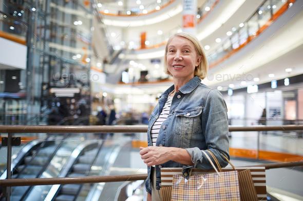 Mature lady enjoying shopping - Stock Photo - Images