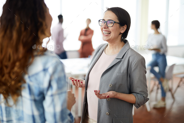 Cheerful Businesswoman Talking to Colleague - Stock Photo - Images