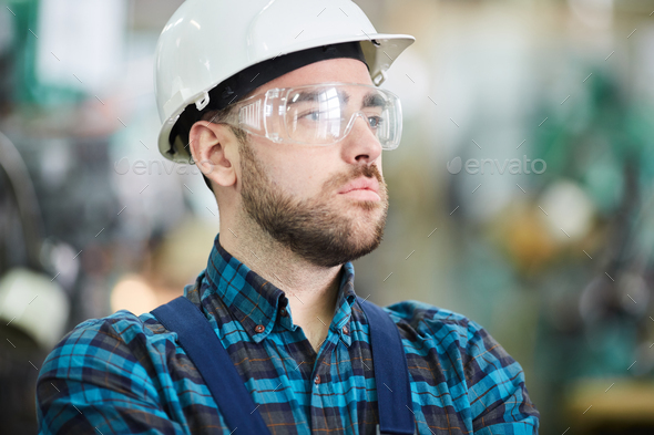 Pensive Factory Worker - Stock Photo - Images