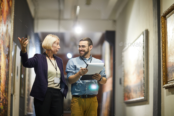 Woman Curating Art Gallery - Stock Photo - Images