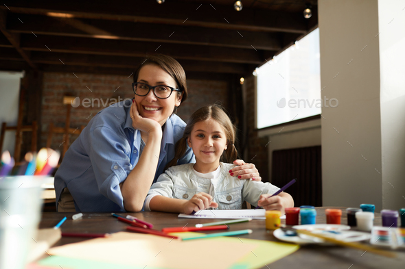 Mother and Daughter Posing at Home - Stock Photo - Images