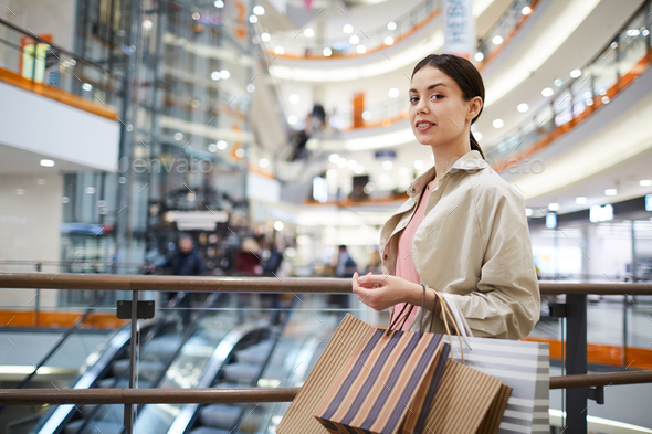 Beautiful lady shopaholic in mall - Stock Photo - Images