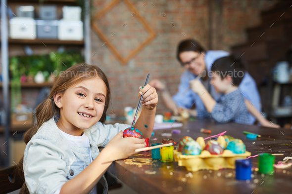 Girl Painting Easter Eggs - Stock Photo - Images